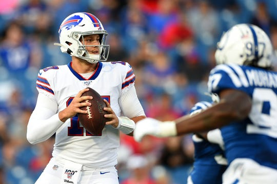Buffalo Bills quarterback Josh Allen (17) drops back to pass against the Indianapolis Colts during the first quarter at New Era Field.