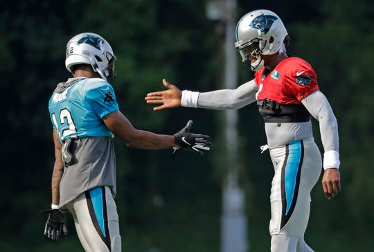 Panthers quarterback Cam Newton, left,  will look to wide receiver DJ Moore more often in 2019 following the offseason departure of top wideout Devin Funchess.