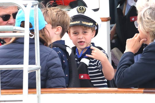 Prince George watches the inaugural Kings Cup regatta hosted by his parents, Prince William and Duchess Kate of Cambridge, on Aug. 8, 2019 in Cowes, England.
