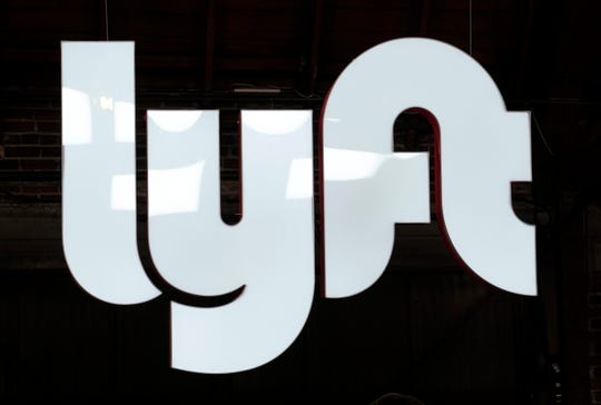 This March 29, 2019, file photo shows a sign for Lyft in Los Angeles.  Lyft is reporting strong revenue growth but deep losses in its second quarter, a trend that it has so far been unable to reverse. The ride-hailing company on Wednesday, Aug. 7, posted revenue of $867.3 million, up 72% from the same time last year.