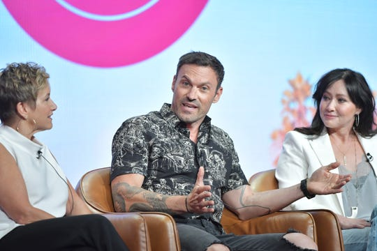 "Gabrielle Carteris, left, and Shannen Doherty listen as Brian Austin Green makes a point during the ""BH 90210"" panel."