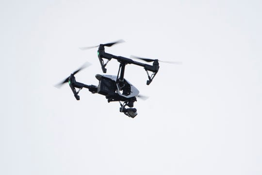 A drone flow by investigator flies over the scene of a small plane crash in a residential neighborhood in Upper Moreland, Pa., Thursday, Aug. 8, 2019.