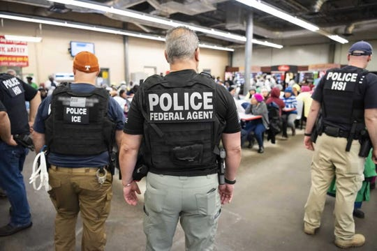 A handout photo made available by the US Department of Homeland Security showing US Immigration and Customs Enforcement's (ICE) Homeland Security Investigations (HSI) executing multiple federal criminal search warrants at one of the undisclosed seven agricultural processing plants across Mississippi on the morning 07 August 2019.