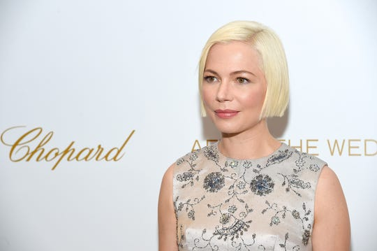 """Being a mother is my primary identity, and it relates to everything I see and do and think,"" says Michelle Williams, seen here at Tuesday's ""After the Wedding"" premiere in New York. ""Motherhood has sort of reinvented me completely, so the lens that I see the whole world through is as a mother."""
