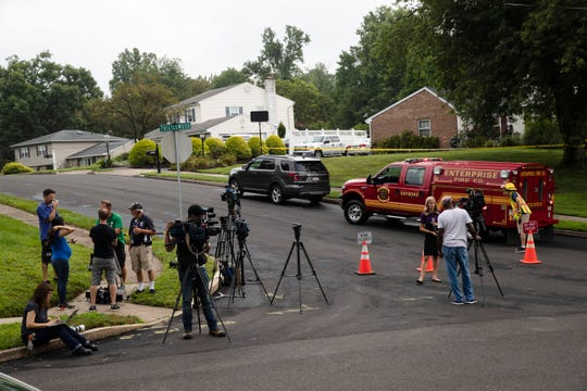 Members of the media gather near the location of a small plane crash in a residential neighborhood in Upper Moreland, Pa., Thursday, Aug. 8, 2019.