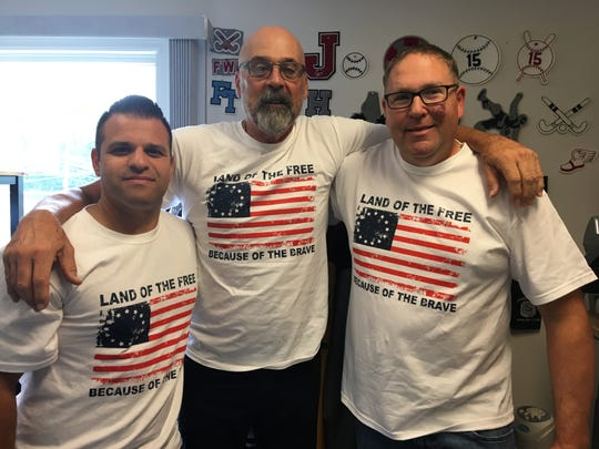 Left to right: Rob Calamunci, Bill McNamara and Mike Schulze wearing the Betsy Ross American Flag T-shirts that are serving as a fundraiser for the Sanner family.