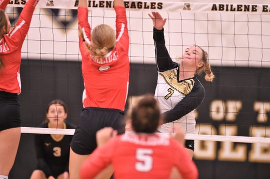 Abilene High's Gentri Anderson (7) follows through on a spike against Holliday in the first match of the 2019 Bev Ball Classic at Eagle Gym on Friday, Aug. 9. The Lady Eagles won the match in three sets.