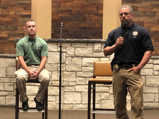 Abilene police Det. Christopher Milliorn, left, listens as Sgt. Jason Haak addresses a crowd of about 100 people inside Southern Hills Church of Christ Thursday. The two discussed online tips for parents looking to keep their children safe from predators using the internet as a hunting ground.