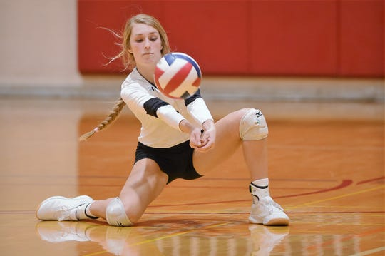 Wylie libero Pierson Sanders (1) reaches to return a serve against Burleson during the Bev Ball Classic at Cooper on Friday, Aug. 9, 2019. The Lady Bulldogs bring back six seniors and a lot of experience as they try to build in second year in Class 5A.