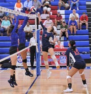 Jim Ned's Kylie Gwinn (3) battles a Cooper player at the net during pool play at the Bev Ball Classic on Friday, Aug. 9, 2019, at Cougar Gym. Cooper won the match 25-10, 25-16,