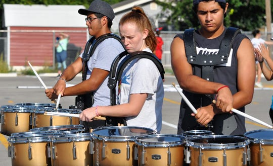 Members of the Abilene High School band percussion section rehearse during marching band camp on Thursday.