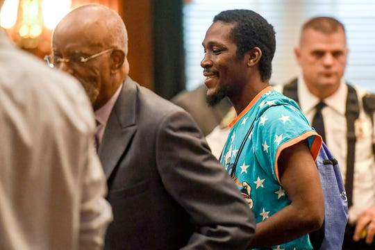 Johnnie Rush leaves the courtroom after sitting in on ex-officer Chris Hickman's plea hearing August 9, 2019. Along with assault by strangulation, Hickman pleaded to two misdemeanors: communicating threats and assault while inflicting serious injury. He committed those crimes in 2017 against Rush, who was stopped for suspected jaywalking and trespassing by walking through the parking lot of a business closed for the night.