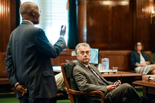 """Todd Williams listens as civil rights attorney James """"Fergie"""" Ferguson addresses Superior Court Judge Bill Coward during the plea hearing for ex-officer Chris Hickman August 9, 2019 in Asheville."""