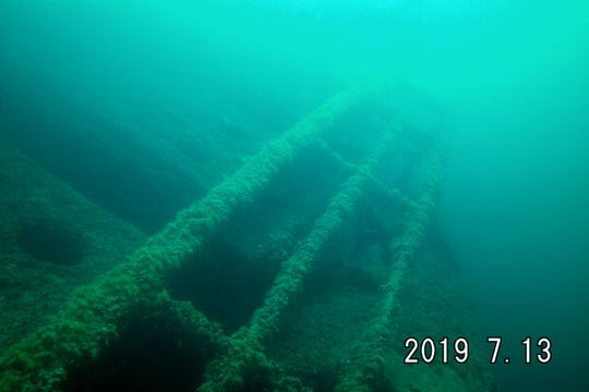 The railings of the Cedarville, a shipwreck on the Straits of Mackinac that sank in 1965, is photographed during a dive by Robert Rininger of Charlotte on July 13, 2019.