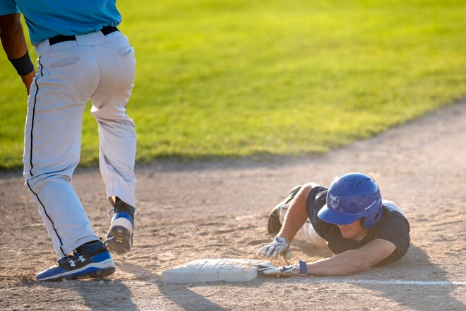 Mid Michigan Tigers Zack Williams (3) slides back to first before Berea Blue Sox infielder Zac Johnson (33) catches the ball during the NABF World Series on Thursday, Auh. 8, 2019 at C.O. Brown Stadium in Battle Creek, Mic