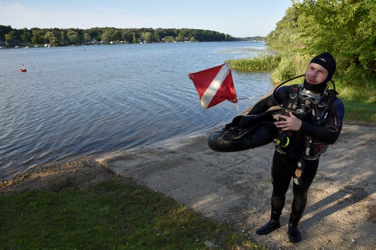 """Blade Rohloff of Kalamazoo exits Long Lake in Delton on Wednesday, August 7, 2019, saying he worked on his navigation skills as visibility was difficult. """"I was on the money for the most part,"""" he said. """"A little west of that buoy."""""""