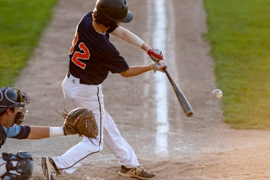 Mid Michigan Tigers' Chris Lowe (32) hits the ball during the NABF World Series on Thursday, Auh. 8, 2019 at C.O. Brown Stadium in Battle Creek, Mich.