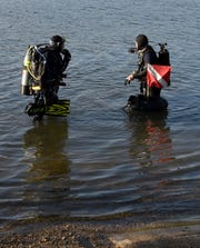 Two divers participate in a dive at Long Lake in Delton during a weekly free local dive led by Sub-Aquatics Sports and Service on Wednesday, August 7, 2019.