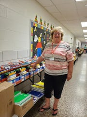 Eloise Wescott with some of the school supplies collected by the Whitney Point Friendship Tree.