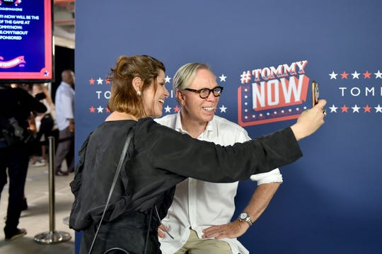 Designer Tommy Hilfiger poses backstage at the #TOMMYNOW Women's Fashion Show during New York Fashion Week in 2016. Hilfiger will be at the Big Flats Barnes & Noble on Saturday, Aug. 10, 2019.