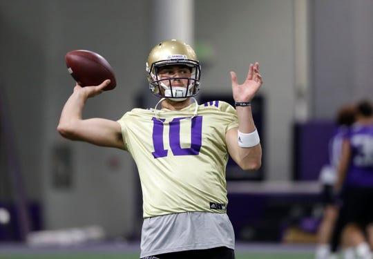 Washington quarterback Jacob Eason readies a throw during an NCAA football practice Monday, Aug. 5, 2019, in Seattle.
