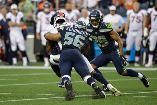 Seattle Seahawks linebacker Mychal Kendricks (56) tackles Denver Broncos wide receiver DaeSean Hamilton, left, during the first half of an NFL football preseason game, Thursday, Aug. 8, 2019, in Seattle.