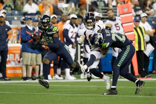 Seattle Seahawks defensive back Marquise Blair, right, hits Denver Broncos wide receiver Nick Williams, center, drawing an unnecessary roughness penalty during the second half of an NFL football preseason game, Thursday, Aug. 8, 2019, in Seattle.