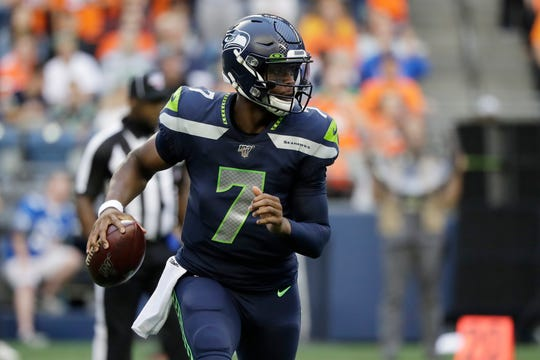 Seattle Seahawks quarterback Geno Smith looks to pass during the first half of the team's NFL football preseason game against the Denver Broncos, Thursday, Aug. 8, 2019, in Seattle.