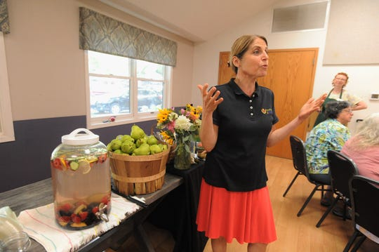 Bounty & Soul founder and director of programs, Ali Casparian, welcome people to the weekly market at St. James Episcopal Church on Aug. 6.