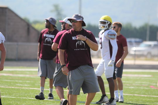 Owen High School head football coach Nathan Padgett leads practice on the field at Warhorse Stadium, which will the site of the third annual Stampede in the Valley on Aug. 20.