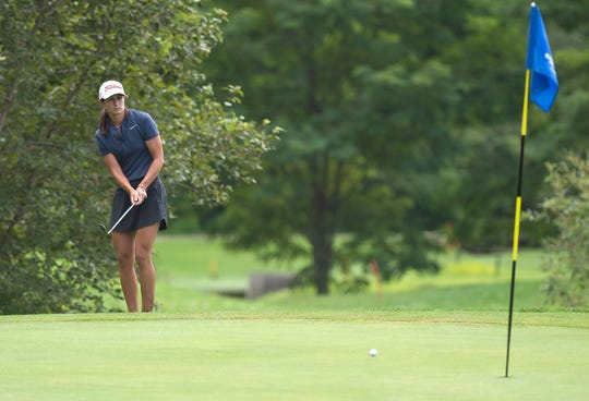 Carson Laderoute chips onto the seventh green during the final round of the 2019 Vermont women's amateur golf championship at Ralph Myhre Golf Course in Middlebury on Thursday, Aug. 8.