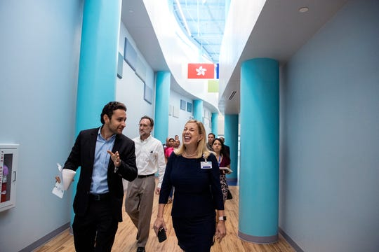 Nick Gignac, left, and Kimberly Bissell, principal of Windsor Park Elementary School, lead a tour through the school on Friday, August 9, 2019. Gignac Architects designed the elementary school.