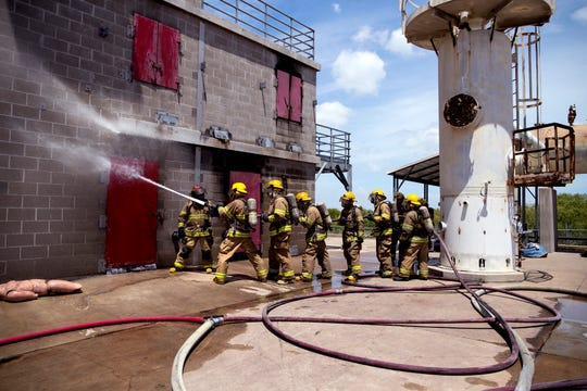 Cadets in the Refinery Terminal Fire Company Training Academy run through a drill at the academy on Friday, Aug. 9, 2019. The Refinery Terminal Fire Company supplies firefighters trained in fighting industrial fires and accidents to cooperative members. It is the largest nonprofit industrial firefighting group in the United States.
