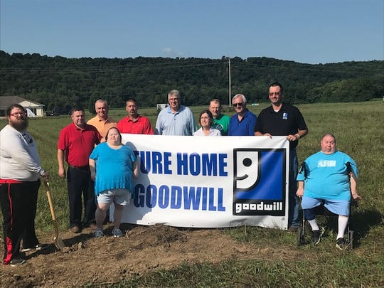 Staff of Goodwill and companies related to the project pose at a groundbreaking ceremony on Aug. 9, 2019