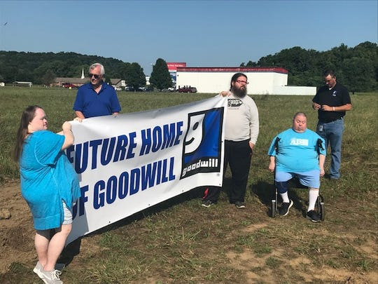 Marvin Jones, CEO of Goodwill in South C, addresses a small crowd at a groundbreaking ceremony on Aug. 9, 2019.