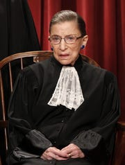 Associate Justice Ruth Bade Ginsburg is seen during the group portrait at the Supreme Court Building in Washington, Friday, Oct. 8, 2010.