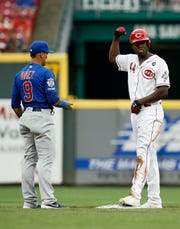 Cincinnati Reds right fielder Aristides Aquino (44) flexes at second base after hitting an RBI double in the first inning of the MLB National League game between the Cincinnati Reds and the Chicago Cubs at Great American Ball Park in downtown Cincinnati on Thursday, Aug. 8, 2019. The game was tied after three innings.