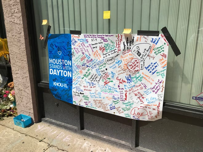 Houston, Texas, residents penned messages of support and love to Dayton, Ohio, in the wake of the Aug. 4, 2019, mass shooting in the Ohio city's Oregon District. The sign was taped to a window near the shooting scene Aug. 9, 2019.