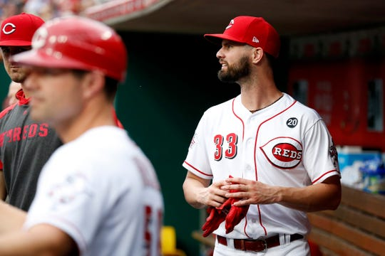 Cincinnati Reds left fielder Jesse Winker (33) walks the dugout in the first inning of the MLB National League game between the Cincinnati Reds and the Chicago Cubs at Great American Ball Park in downtown Cincinnati on Thursday, Aug. 8, 2019. The game was tied after three innings.