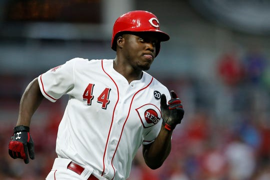 Cincinnati Reds right fielder Aristides Aquino (44) runs the bases on a two-run home run in the third inning of the MLB National League game between the Cincinnati Reds and the Chicago Cubs at Great American Ball Park in downtown Cincinnati on Thursday, Aug. 8, 2019. The game was tied after three innings.
