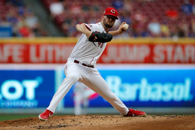 Cincinnati Reds starting pitcher Alex Wood (40) delivers a pitch in the first inning of the MLB National League game between the Cincinnati Reds and the Chicago Cubs at Great American Ball Park in downtown Cincinnati on Thursday, Aug. 8, 2019. The game was tied after three innings.
