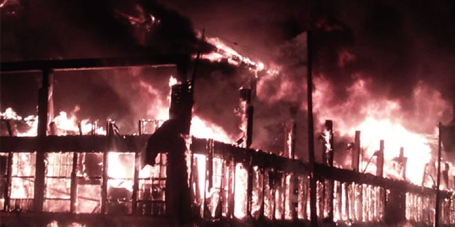 A massive warehouse fire on Laurel Avenue in Hamilton evacuated nearby homes on July 25.