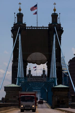 A view of the John A. Roebling Suspension Bridge on Friday, Aug. 9, 2019, in Downtown Cincinnati.