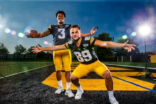 Tyrone Tracy, Jr. and Nico	Ragaini stand for a photo during Hawkeye football media day Friday, Aug. 9, 2019.
