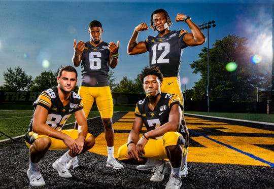 Nico Ragaini, Ihmir Smith-Marsette, Brandon Smith and Tyrone Tracy  Jr. stand for a photo during Hawkeye football media day Friday, Aug. 9, 2019.