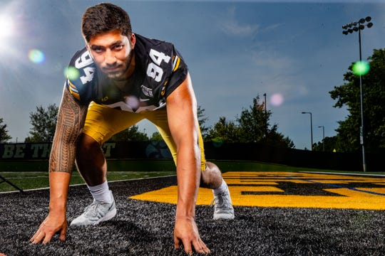 A.J. Epenesa stands for a photo during Hawkeye football media day Friday, Aug. 9, 2019.