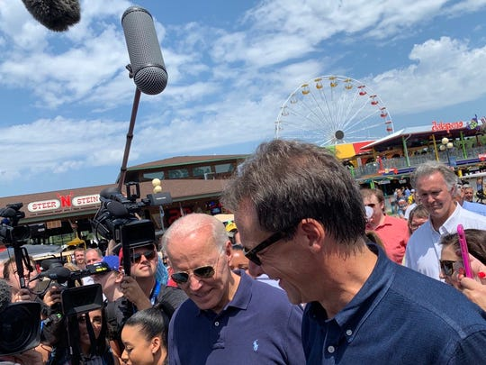 Steve Bullock's media gaggle ran into Joe Biden's on the way off the Des Moines Register Political Soapbox on Thursday, Aug. 8, 2019 at the Iowa State Fair. The two 2020 presidential candidates greeted each other and shook hands. Bullock joked that he warmed the crowd up for the former vice president.
