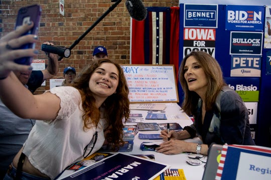 Marianne Williamson, author and 2020 presidential hopeful, poses for a selfie inside the Varied Industries Building during the Iowa State Fair on Friday, Aug. 9, 2019, in Des Moines.