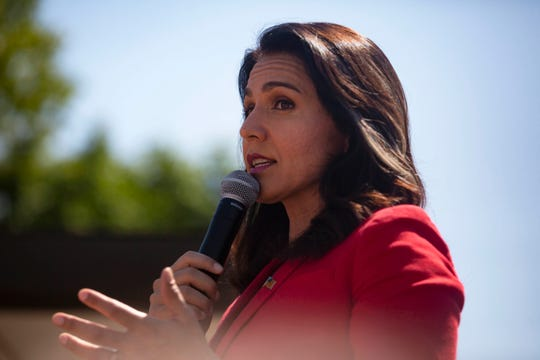 U.S. Rep. Tulsi Gabbard, D-Hawaii, a presidential candidate, delivers a speech at the Des Moines Register Political Soapbox on Friday, Aug. 9, 2019.