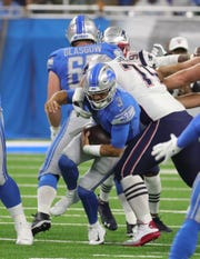 Detroit Lions quarterback Tom Savage is sacked by New England Patriots linebacker Shilique Calhoun during first half action Friday, August 8, 2019 at Ford Field, in Detroit Mich.
